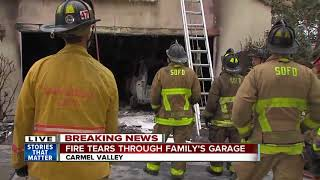 Download Family flees home after fire rips through garage Video