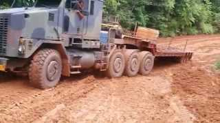 Download Climbing the slippery mountain with the Oshkosh M1070 in worse conditions Video