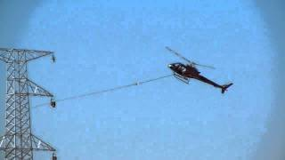 Download helicopter doing a power line pull.MOV Video