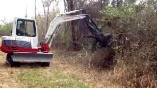 Download Mini Excavator Mowing Logging Road Video
