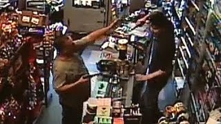 Download Armed robber meets his match - CCTV Video