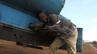Download Kenyan farmer delivers water for drought-hit elephants Video