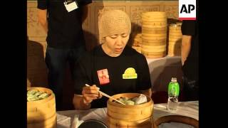 Download Japanese hotdog eating champ in dumpling eating competition Video
