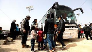 Download Ghouta evacuees arrive in Syria's rebel-held Idlib: monitor Video