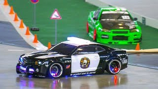 Download RC MODEL DRIFT CARS IN MOTION!! RC CHEVROLET CAMARO POLICE DRIFT CAR, REMOTE CONTROL Video