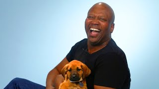 Download Tituss Burgess Plays With Puppies While Answering Fan Questions Video
