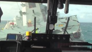 Download Lynx helicopter landing on ship in rough sea Video