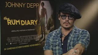 Download Johnny Depp describes meeting ex wife Amber Heard for the first time! Video