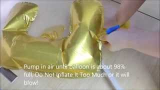 Download Inflating a foil balloon Video