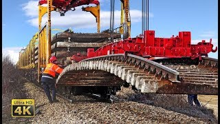 Download Heavy rail machinery - Lifting and removing old rail track panels [4K] Video