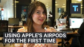 Download People try Apple's wireless AirPods for the first time Video