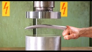 Download Crushing Adamantium with Hydraulic Press Video