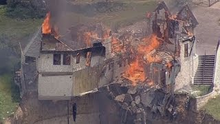 Download Burning down the house: Texas family burn down luxury home that hangs over 75ft cliff Video