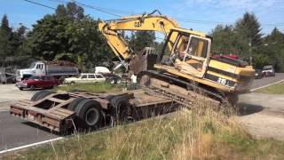 Download Side Loading Cat 315 Excavator Onto Peerless Lowboy Video
