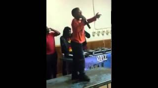 Download Mc Tsotso performing on top of the table Video