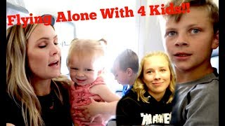 Download Flying Alone With 4 Kids!! Video
