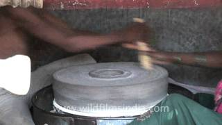 Download Woman grinding grain with a hand mill at Nana village Video