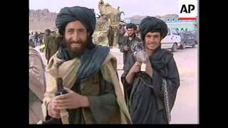 Download Afghan interim leader makes base in Mullah Omar's compound. Video