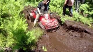 Download 500 Honda Rubicon Stuck In Big Mud Hole Video