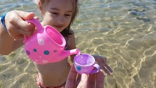 Download Kids playing on the beach . They making ice cream and cakes from sand. Video 2016 Video