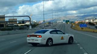 Download Utah Highway Patrol Officer Performs a Slow-Down Maneuver Video