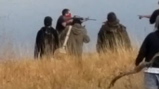 Download Did a DAPL Security Worker Wielding an AR-15 Rifle Try to Infiltrate Native Water Protectors? Video