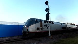 Download Amtrak Train Ready To Reverse Car Goes Around Gates Video