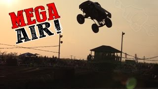 Download Biggest Mega Mud Truck Jumps EVER! Video