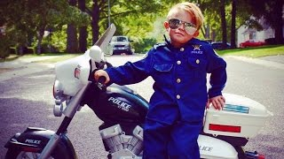 Download 5-Year-Old Boy Wears Police Uniform While Riding Motorcycle To Protect Neighbors Video
