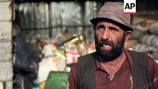 Download Syrian refugees make ends meet by picking through rubbish Video