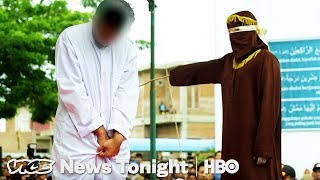 Download Crowds Cheer As Gay Men Are Caned in Indonesia (HBO) Video