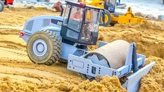 Download RC construction machines at RC-Glashaus! Caterpillar & more in Action! Video