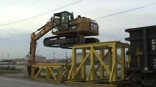 Download Cat 319D LN climbing onto rail car Video