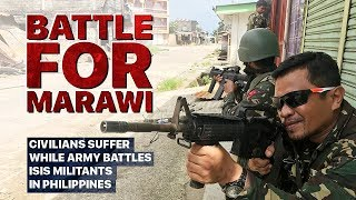Download Battle for Marawi Civilians suffer while army battles ISIS militants in Philippines Video