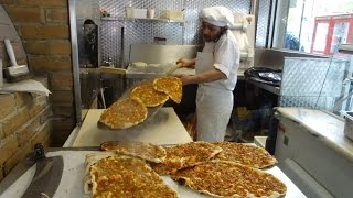 Download Master Baker Gino making Turkish Flat Bread Pizza (Pide) and Lamachun in a wood fired oven, London. Video