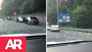 Download $175 mil escapan de un camión blindado en una carretera en Atlanta Video