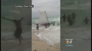 Download Cuban Migrants, Dog Land On Miami Beach Video