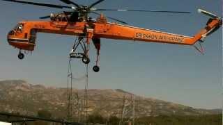 Download Aircrane Lifting A Bridge of a high line transmission lattice tower Video