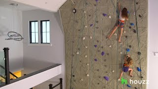 Download This Family Put a 26-Foot Rock Climbing Wall in Their Living Room Video