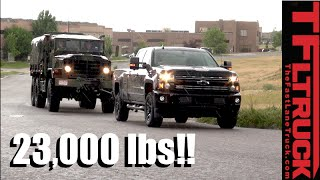 Download Will a 2016 Chevy Silverado HD Pull a 23,000 lbs Military 6X6 M925a2 Up Hill in the Rain? Video