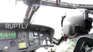 Download Colombia: Emergency services remove bodies from plane crash site Video