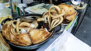 Download Hong Kong Food, Cooking the Cuttlefish. A Street Food Delicacy of Tai O Village Video