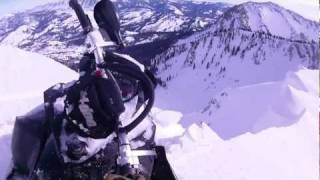 Download 2012 ski doo summit X close call with cliff fall Video