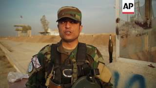Download Christian militia patrol Iraq city taken from IS Video
