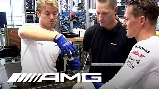 Download Schumacher and Rosberg Build an AMG Engine Video