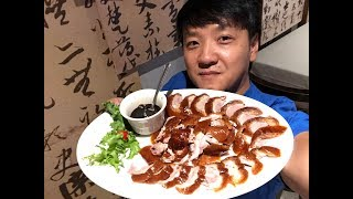 Download Eating ENTIRE Peking Duck & WEIRD Birthday Tradition Video