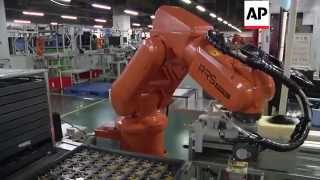 Download Chinese factory workers being replaced by robots - 2015 Video