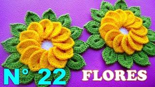 Download Flores tejidas a crochet de 12 pétalos con hojitas para tapetes y centros de mesa paso a paso Video