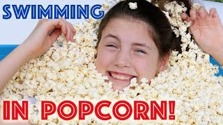 Download SWIMMING IN POPCORN! Kids & Dad swim & try gymnastics in pool full of popcorn! Video
