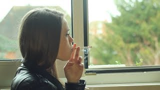 Download Pretty girl smokes a long cork cigarette Video